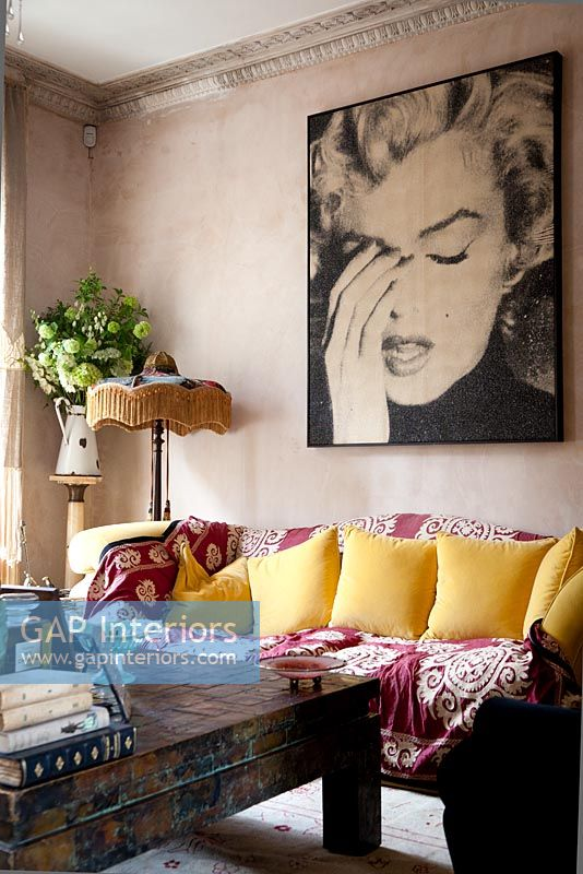 Monroe poster on living room wall