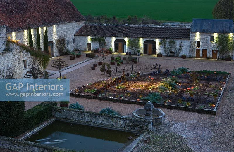 Potager and Golden Fleet Barn lit up at night - Chateau du Riveau