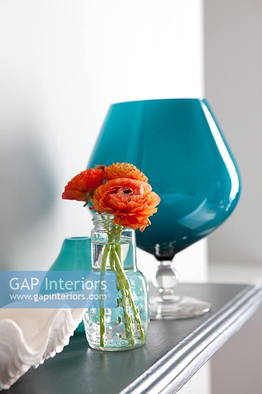 Orange flowers in glass vase