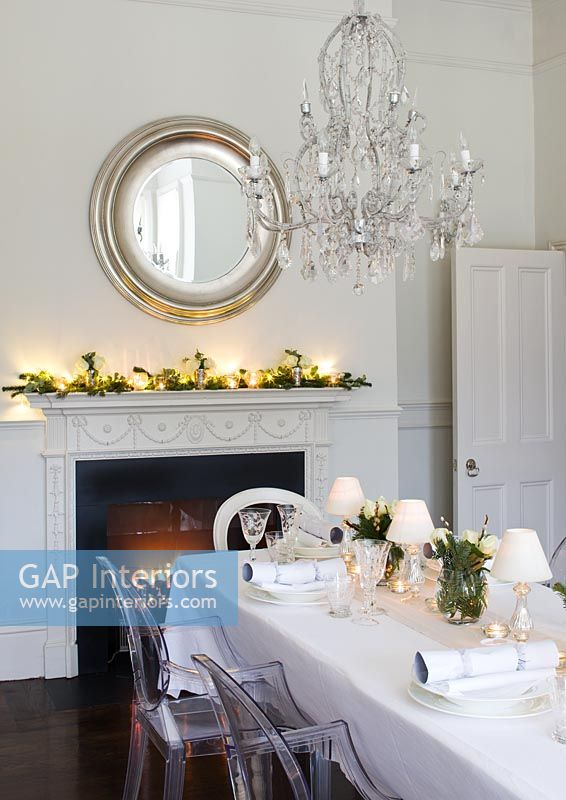 White dining room decorated for christmas meal