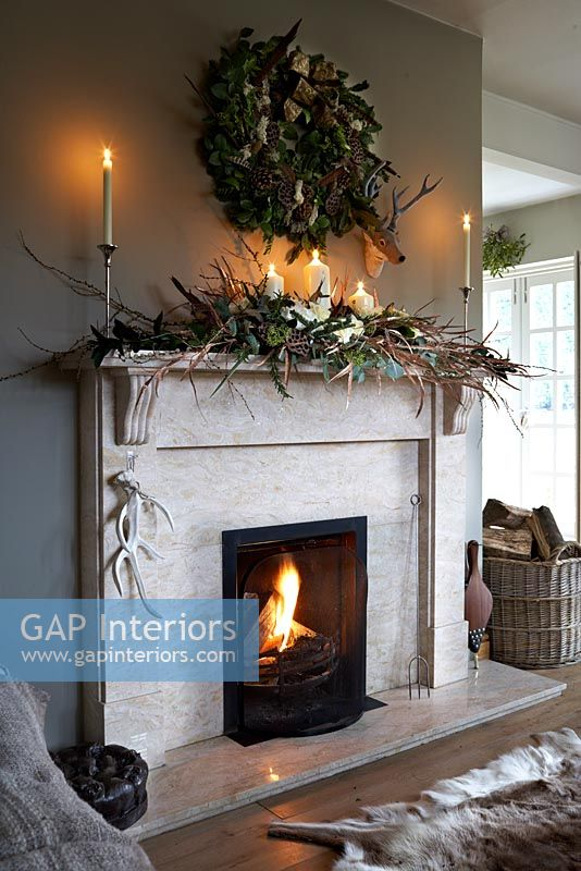 Stone fireplace decorated for christmas
