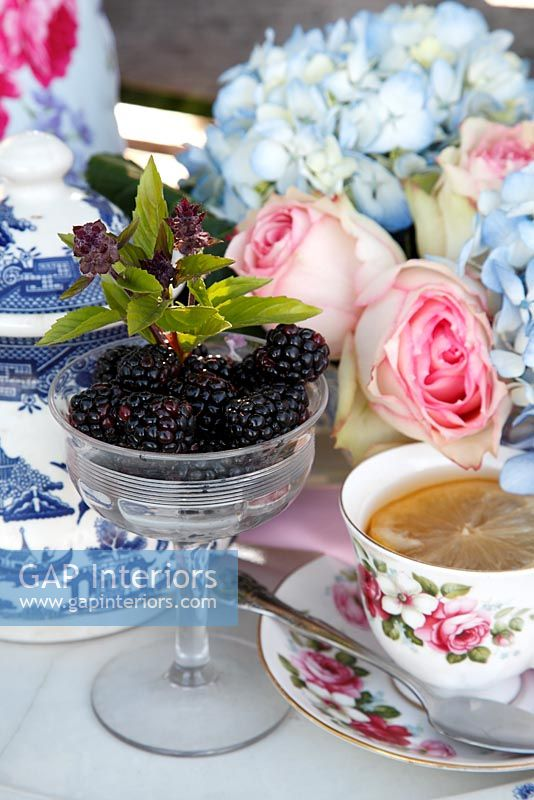 Afternoon tea with cut Roses and Hydrangeas