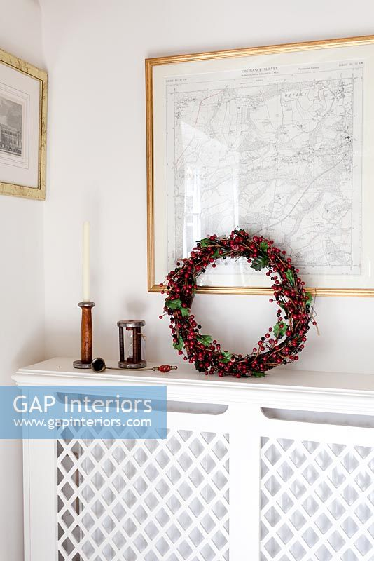 Radiator cover with christmas wreath