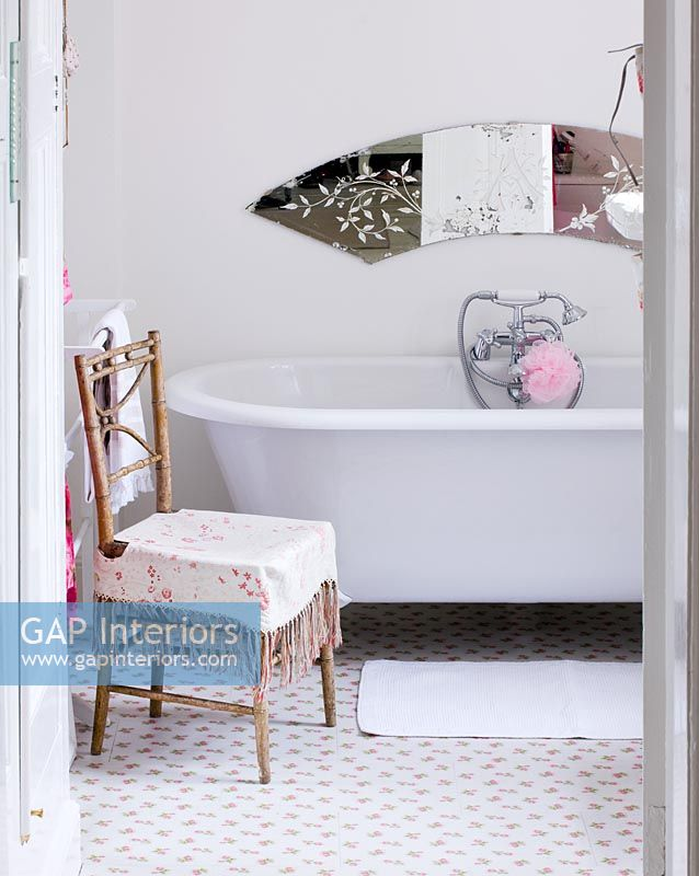 Classic bath and vintage chair