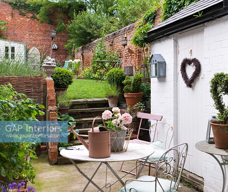 Small courtyard and garden with vintage furniture