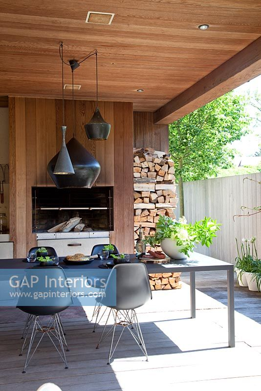 Modern decked patio with fireplace