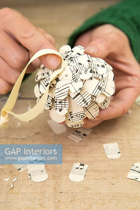 Step by Step guide for making paper cones using music sheet paper - Attaching ribbon