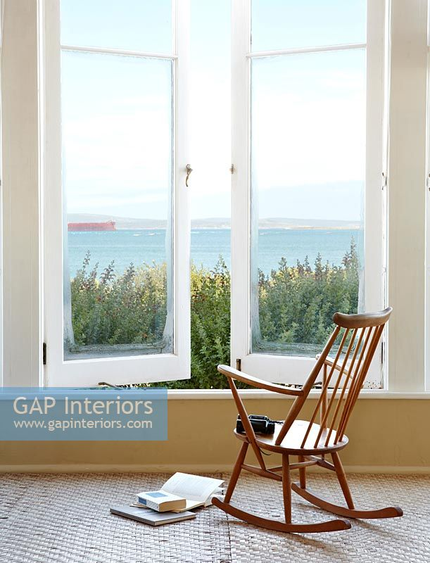 GAP Interiors - Wooden rocking chair by window - Image No: 0117250 ...