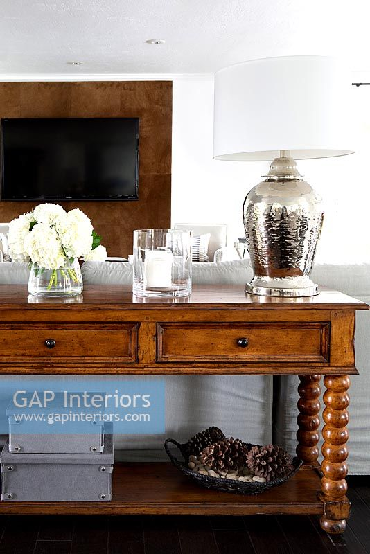 Modern accessories on wooden console table