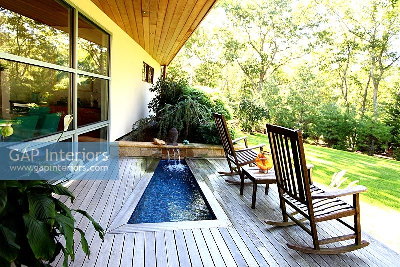 Contemporary raised patio with water feature