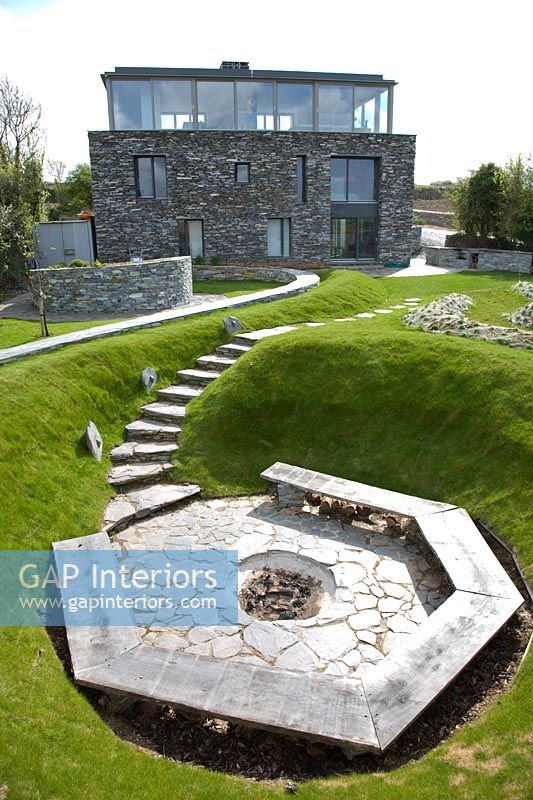 Contemporary garden with sunken patio area