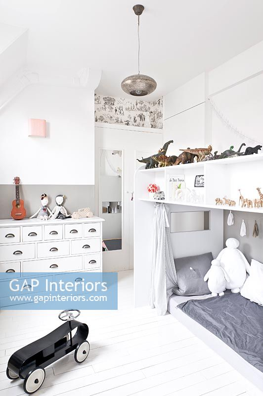 White childs bedroom with storage above bed