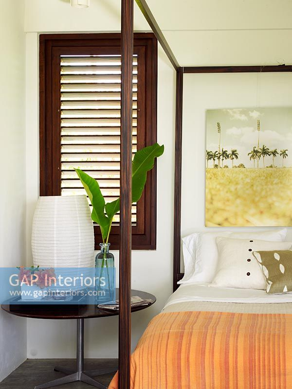 Tropical flowers and foliage on bedside table