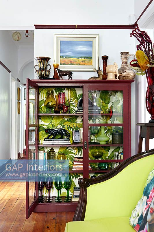 Colourful glassware in display cabinet
