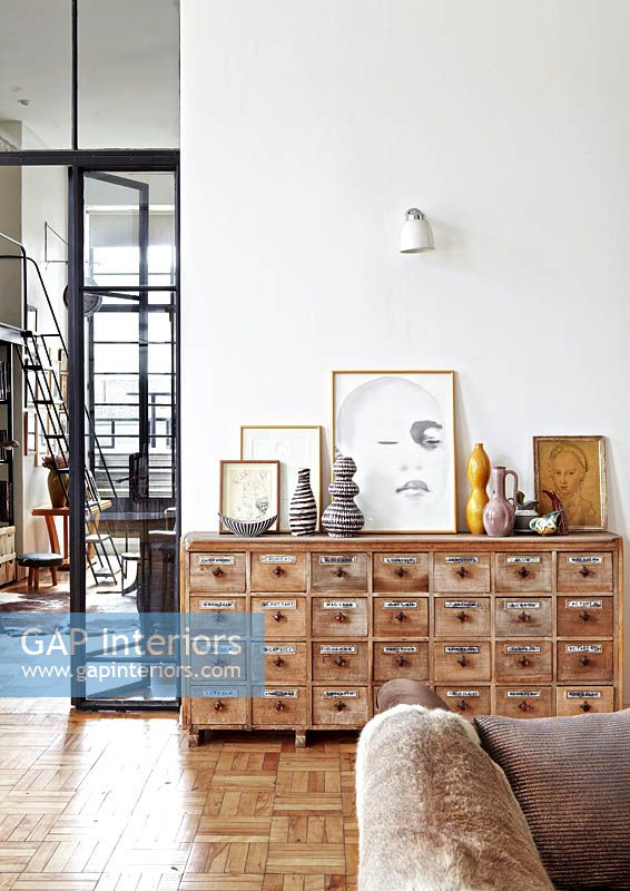 Art and collectibles on vintage chest of drawers
