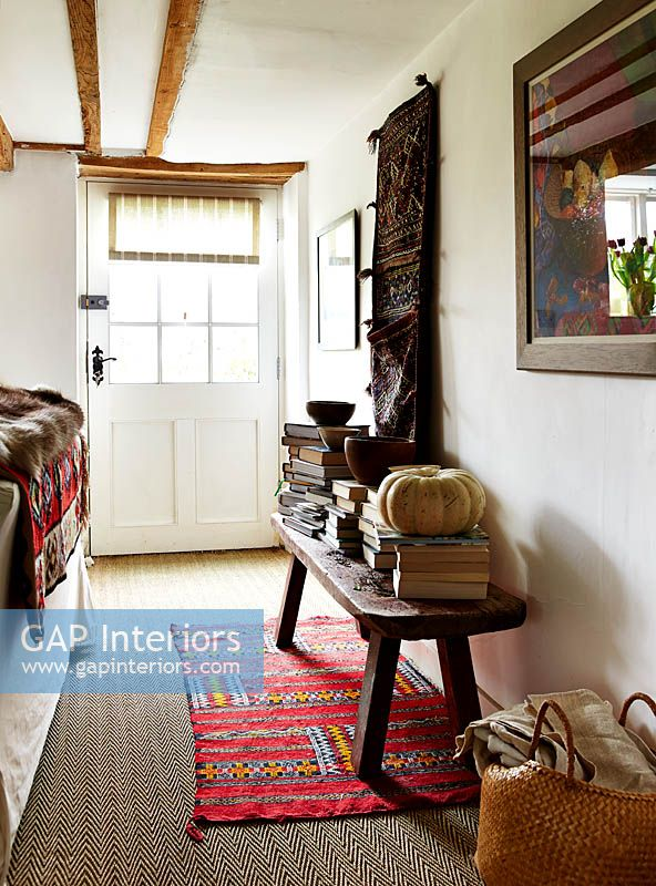 Wooden bench in country hallway