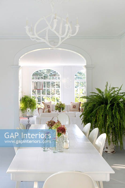 Floral display on white dining table