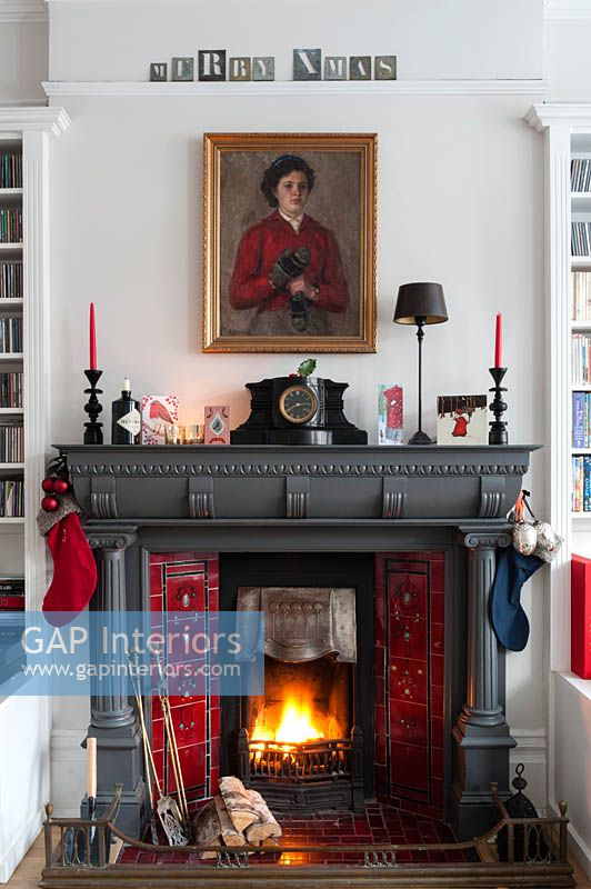 Christmas decorations around period fireplace