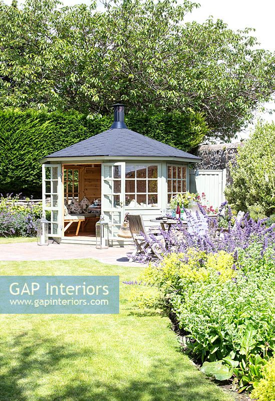 Summerhouse in garden corner