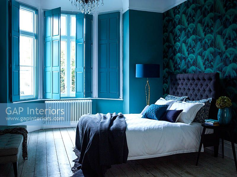 Turquoise shutters at bedroom window
