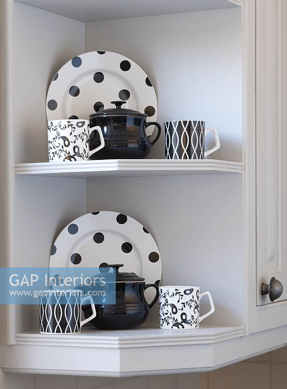 Patterned crockery on kitchen shelves