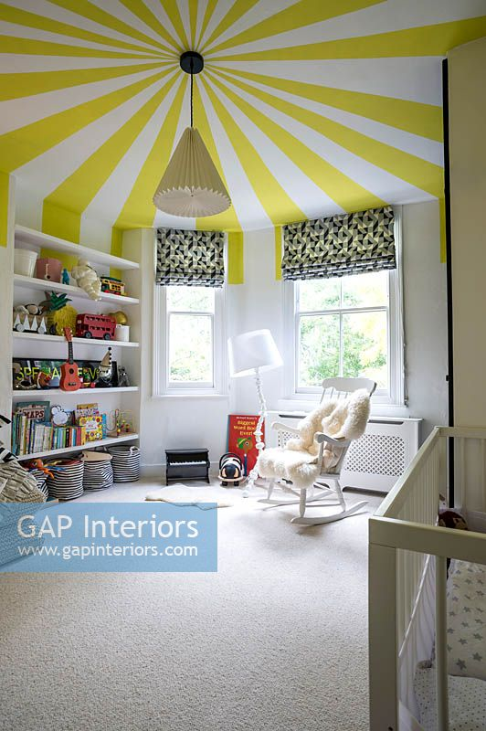 Childrens room with colourful ceiling