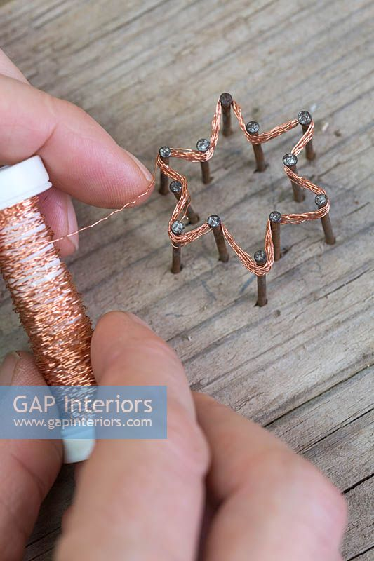 Making copper wire star decorations - Repeat the weaving of the copper wire for roughly 10-12 times, this helps to strengthen the star as well as making the shape more distinctive