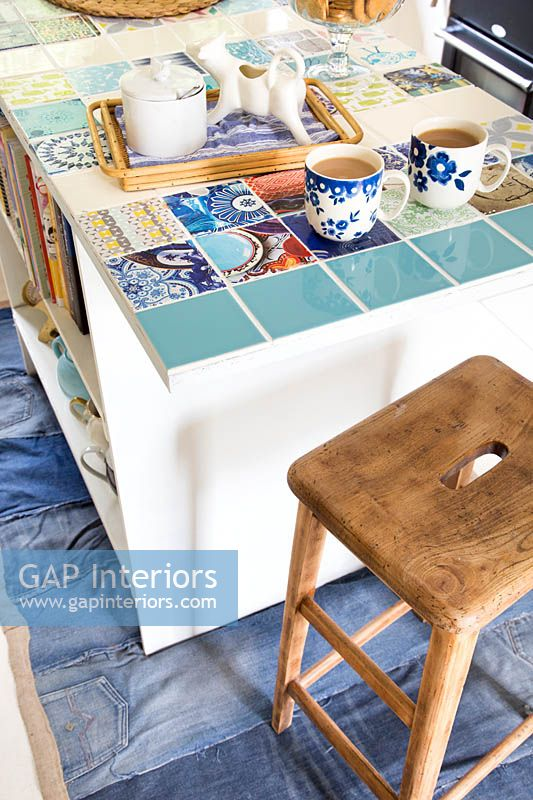 Kitchen island with colourful tiles