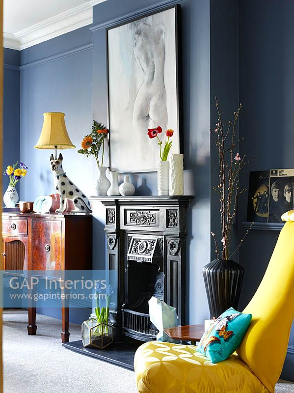 Period fireplace with eclectic accessories