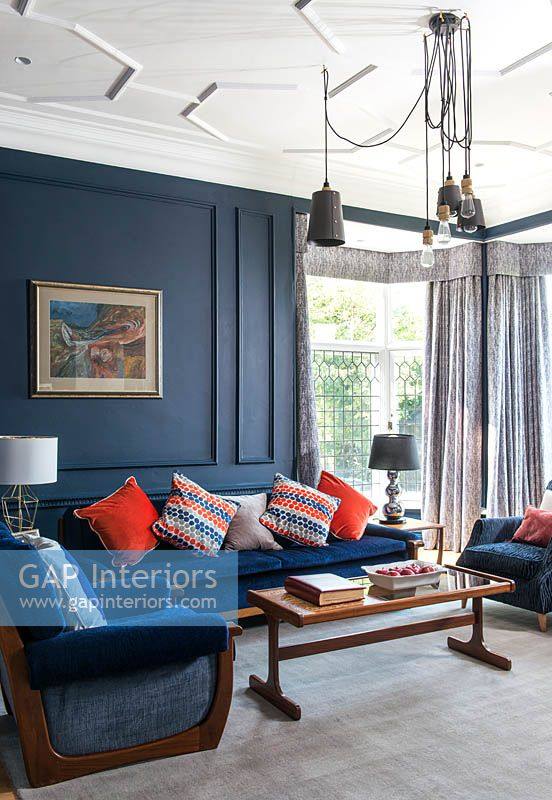 Colourful cushions on blue sofa