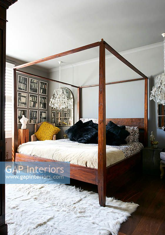 Modern bedroom with four poster bed