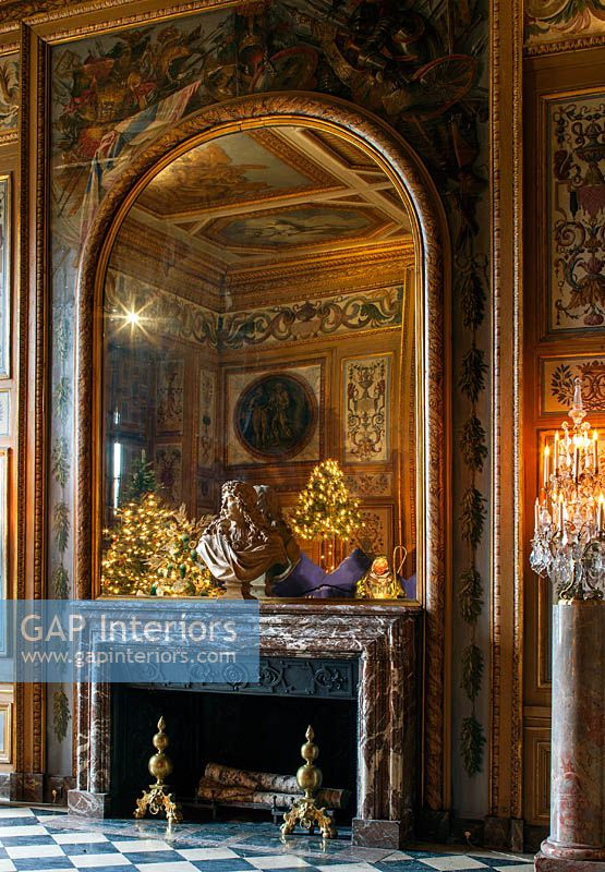 Christmas in the dining room with bust of Le Brun on mantlepiece, Vaux le Vicomte