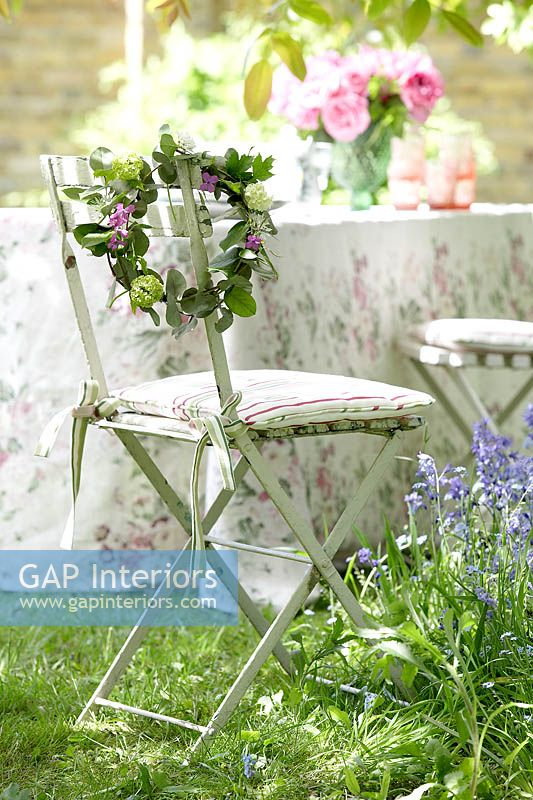 Floral wreath on garden chair