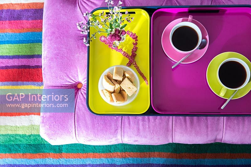 Coffee and biscuits on colourful tray