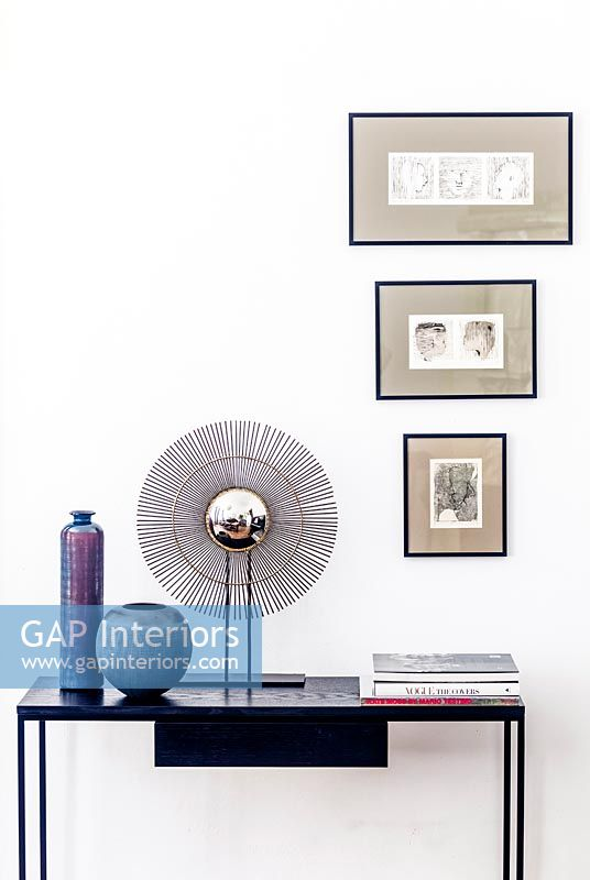 Modern accessories on console table