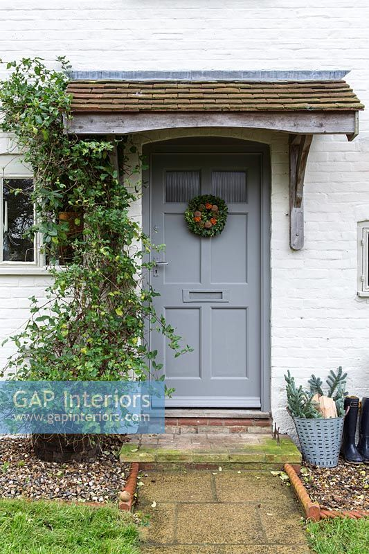 Cottage front door with christmas wreath