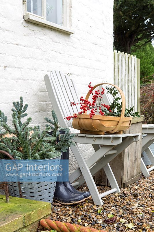 Holly sprig in wooden trug