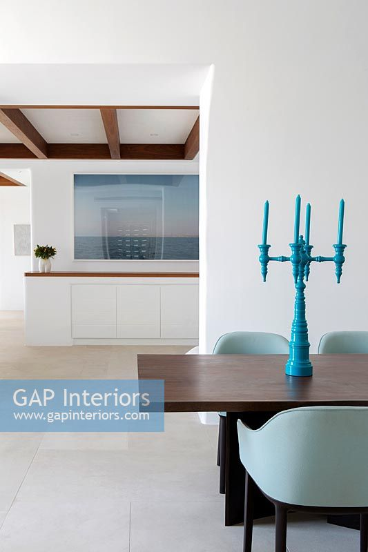 Turquoise candelabra on dining table