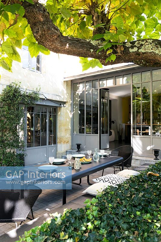 Outside dining area with modern garden furniture
