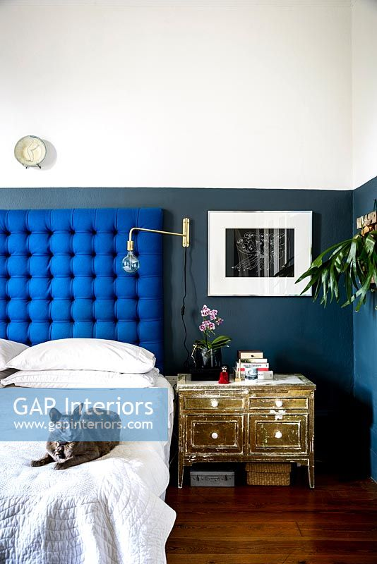 Bed with blue headboard
