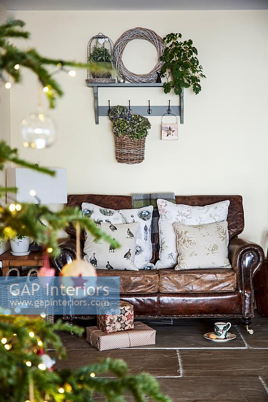 Leather sofa surrounded by christmas decorations