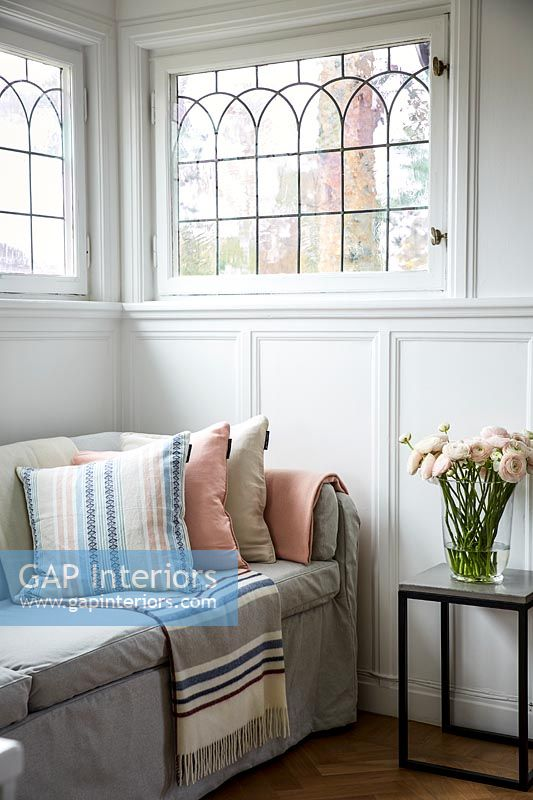Sofa in living room with curved window detail