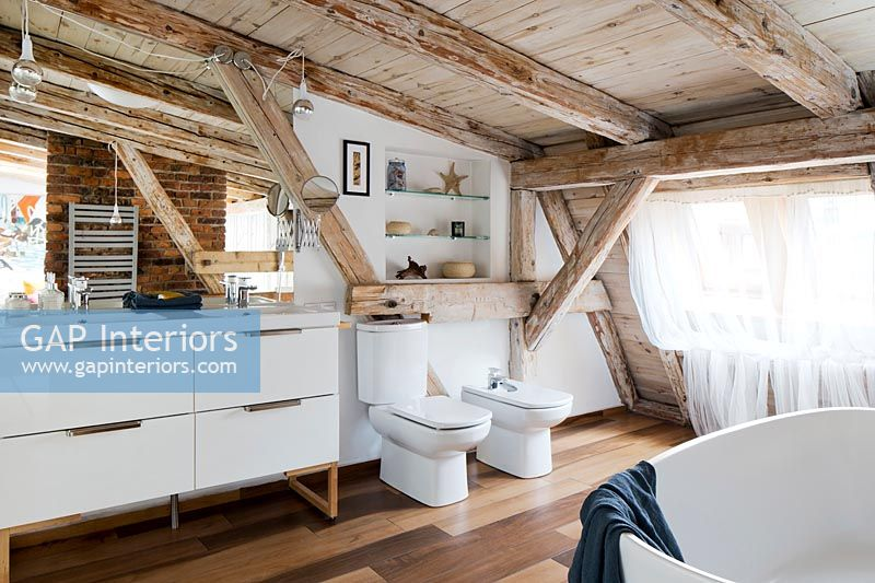 Bathroom with wooden exposed beams