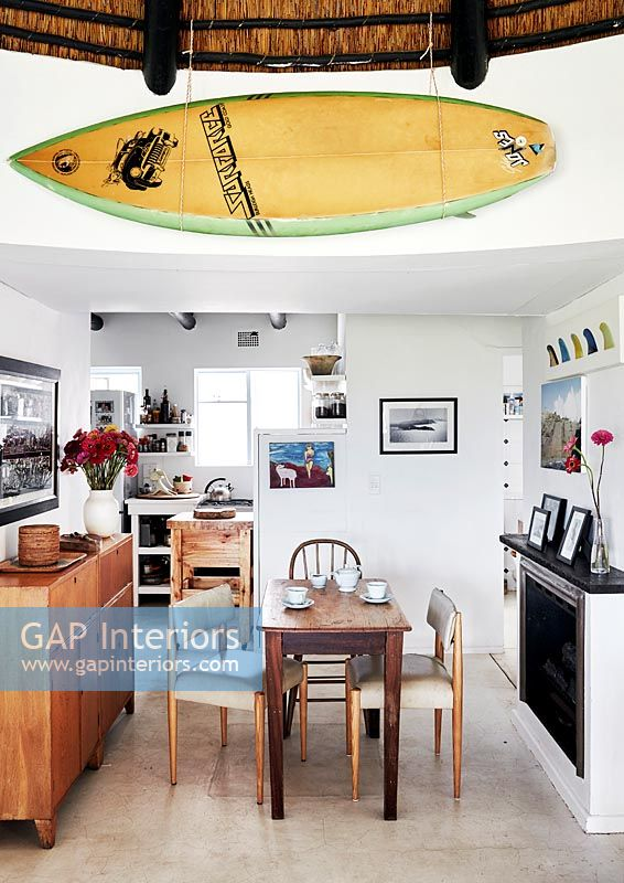 Detail of open plan dining area with surfboard