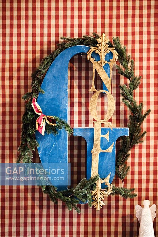Detail of Noel Christmas decoration with letter G