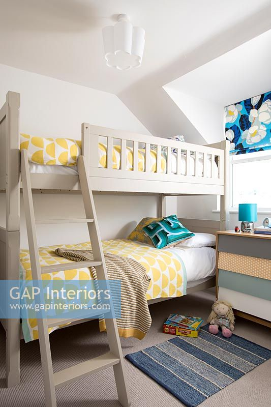 Wooden bunk beds in childrens bedroom