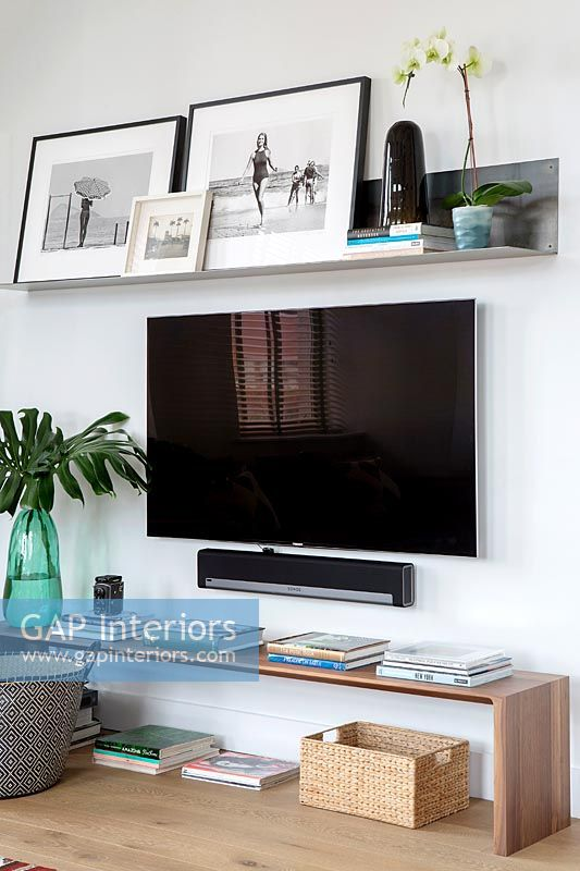 Large wall mounted flat screen television in contemporary living room
