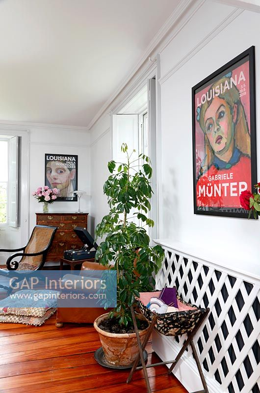 Modern artwork and radiator cover in living room