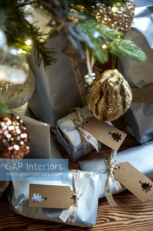 Close up of gifts under the Christmas tree and decorations