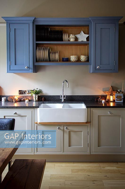 Butler sink and shelf unit in modern country kitchen